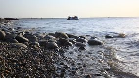 Pebbles Beach and waves splashes with sea sound stock video footage