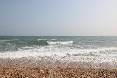 Pebbles beach. Wet pebbles on sea beach Stock Photo