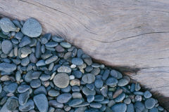 Pebbles and beach wood Royalty Free Stock Photos