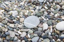 Pebbles with big stone closeup. Pebbles with big round stone closeup Stock Photos