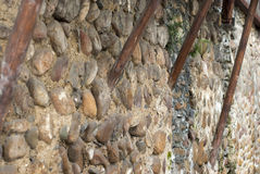 Pebbles built the wall Stock Photos
