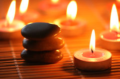 Pebbles and burning candles. For aromatherapy session Royalty Free Stock Photography