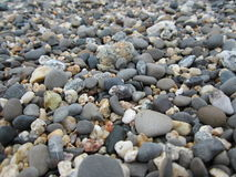 Pebbles on a California beach. Smooth stones on a rocky beach at Half Moon Bay in northern California royalty free stock photos