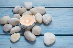 Pebbles and candle Stock Image