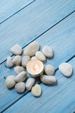 Pebbles and candle Royalty Free Stock Photos