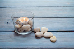 Pebbles and candle Royalty Free Stock Image