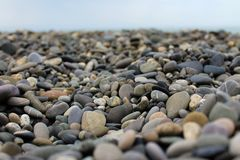 Pebbles close-up against the sky. Stock Images