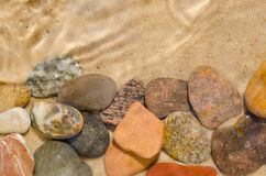 Pebbles composition on stone Royalty Free Stock Photo