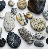 Pebbles in design. Pebbles from beaches and rivers arranged to show off the diverse and attractive designs and markings Stock Photo