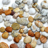 Pebbles in design. Pebbles from beaches and rivers arranged to show off the diverse and attractive designs and markings Royalty Free Stock Image