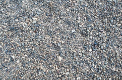 Pebbles evenly. Smooth, joateca a scattering of pebbles on a flat surface Royalty Free Stock Images