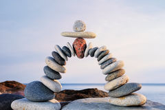 Pebbles Flex. Pebbles curved as arch on the seashore Stock Photo