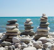 Pyramid of pebbles on a sea beach. Royalty Free Stock Images