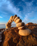 Pebbles in the form of a arch. On sky background Royalty Free Stock Image