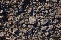 Pebbles of granite. Granite stones that make up a classic beach of Sardinia Royalty Free Stock Photos