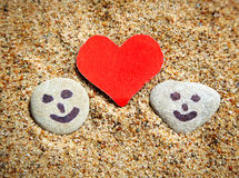 Pebbles and Heart Shape in the Sand Royalty Free Stock Images