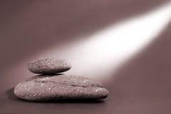 Pebbles and Lightbeam Stock Photography