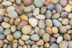 Pebbles in many shapes on the beach, abstract backgound Stock Photography