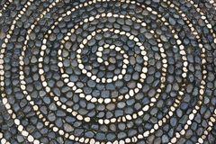 Pebbles mosaic floor with spiral pattern Royalty Free Stock Photo