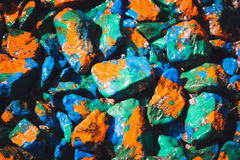 Pebbles painted bright colored paint Royalty Free Stock Photos