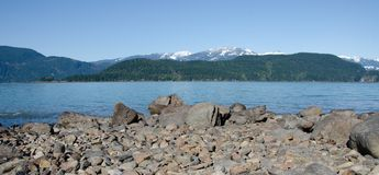 Pebbles, peaks and lake waters. At Green Point, Sasquatch Provincial Park Royalty Free Stock Photos