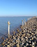 Pebbles and poles by the road in Camargue, France Royalty Free Stock Image