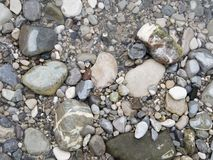 Pebbles on the river bank Royalty Free Stock Image