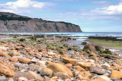 Robin Hoods Bay, Yorkshire, England. Pebbles on Robin Hoods Bay, Yorkshire, England at low tide. Famous for it`s fossils, this is a tourist attraction stock photography