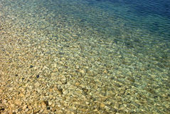 Pebbles rocks covered with water Royalty Free Stock Photo