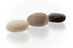 Pebbles in a row - focus on 3th Stock Photos