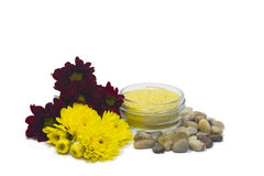 Pebbles, salt and flowers. On isolated white background Royalty Free Stock Photo