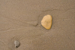Pebbles on Sand background texture Stock Photo