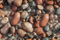 Pebbles in sand. Royalty Free Stock Photos