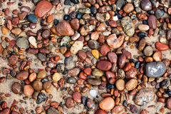 Pebbles on the sand Royalty Free Stock Images