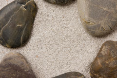 Pebbles in sand ring formation Royalty Free Stock Images