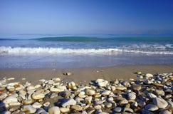 Pebbles on a sandy beach Stock Image