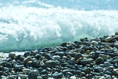 Pebbles and sea Royalty Free Stock Images