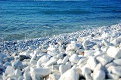 Pebbles sea beach Stock Photos