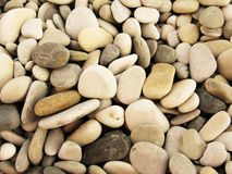 Pebbles on the sea shore background photo Royalty Free Stock Images