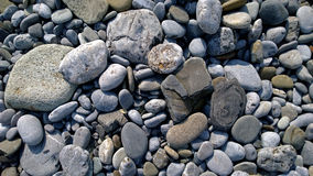Pebbles on the sea shore. Horizontal view Stock Image