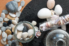 Pebbles and seashells. Arrangement and decoration with pebbles, seashells and bottles close up Stock Image