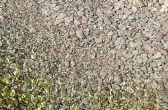Pebbles in shallow sea. Texture of pebbles in shallow sea water royalty free stock photography