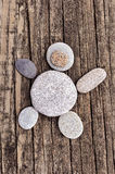 Pebbles in a shape of a teddy bear Stock Images