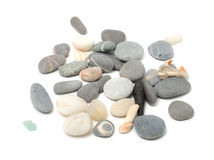 Pebbles And Shells. Scattered pebbles and shells isolated on a white background Stock Photo