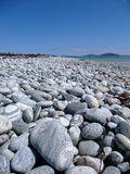 Pebbles by the shore Stock Photo