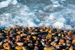 Pebbles in a shore of an island Stock Photo