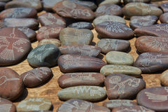 Pebbles souvenirs with Nazca lines. In Peru Stock Images