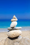 Pebbles stack balance over blue ionian sea Royalty Free Stock Photos