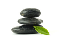 Pebbles stack and green leaf Royalty Free Stock Photos