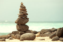 Pebbles stack over sea Stock Photography